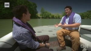 Dr. Sanjay Gupta discusses coal ash with Catawba Riverkeeper Sam Perkins by Allen (Lake Wylie)
